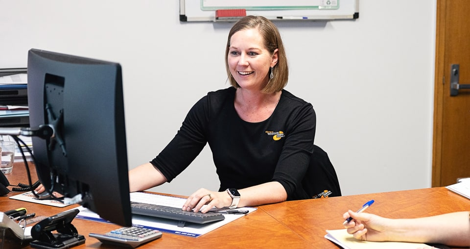 Whitson Dawson bookkeeper helping client
